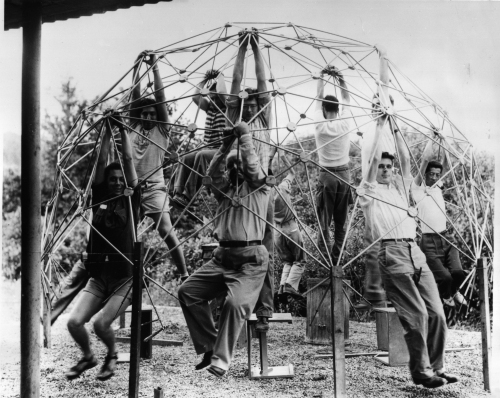 R. Buckminster Fuller and students with the first model of Fuller's Geodesic Dome, 1948, made at the Institute of Design, Chicago. Courtesy the Estate of R. Buckminster Fuller.