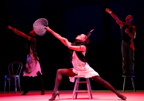Alvin Ailey American Dance Theater's R. Deshauteurs, R. Robinson and V. Gilmore in Alvin Ailey's Blues Suite. Photo by Paul Kolnik.